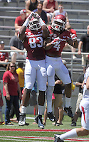 NWA Democrat-Gazette/Michael Woods --04/25/2015--w@NWAMICHAELW... University of Arkansas receiver Keon Hatcher (4) and tight end Jeremy Sprinkle (83) celebrate after Hatchers touchdown during the 2015 Red-White game Saturday afternoon at Razorback Stadium in Fayetteville.