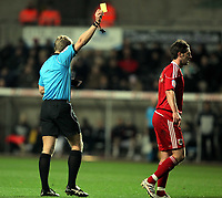 ATTENTION SPORTS PICTURE DESK<br /> Pictured: Referee G D Scott (L) booking Liam Fontaine of Bristol (R) for his foul against Marvin Emnes of Swansea. <br /> Re: npower Championship, Swansea City FC v Bristol City Football Club at the Liberty Stadium, south Wales. Wednesday 10 November 2010
