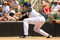 Trayce Thompson #24 of the Kannapolis Intimidators squares to bunt against the Hagerstown Suns at Fieldcrest Cannon Stadium on May 30, 2011 in Kannapolis, North Carolina.   Photo by Brian Westerholt / Four Seam Images