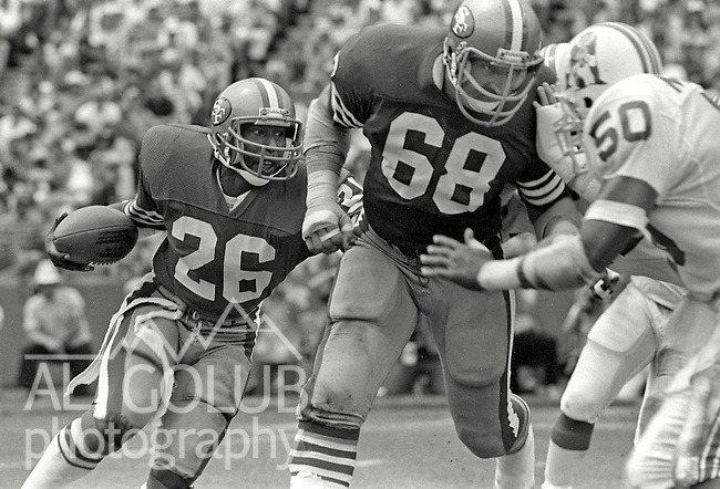 San Francisco 49ers vs. New England Patriots at Candlestick Park Sunday, August 14, 1983..Pre-season Game..San Francisco 49ers Guard John Ayers (68) blocking New England Patriots Linebacker Larry McGrew (50) for 49ers Running Back Wendell Tyler (26)..
