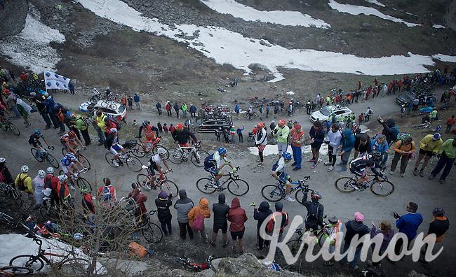 grupetto up the dirt roads of the Colle delle Finestre (2178m)<br /> <br /> Giro d'Italia 2015<br /> stage 20: Saint Vincent - Sestriere (199km)