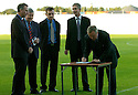31/08/2004   Copyright Pic : James Stewart.File Name : jspa12_falkirk_v_stirling_albion.FALKIRK COUNCIL LEADER DAVID ALEXANDER SIGNS THE AGREEMENT TO BUILD THE NORTH STAND AT THE FALKIRK STADIUM WATCH BY REPS OF MOWLAM, FALKIRK STADIUM AND FALKIRK FC....Payments to :.James Stewart Photo Agency 19 Carronlea Drive, Falkirk. FK2 8DN      Vat Reg No. 607 6932 25.Office     : +44 (0)1324 570906     .Mobile  : +44 (0)7721 416997.Fax         :  +44 (0)1324 570906.E-mail  :  jim@jspa.co.uk.If you require further information then contact Jim Stewart on any of the numbers above.........