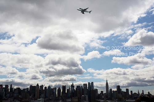 Space shuttle Enterprise, mounted atop a NASA 747 Shuttle Carrier Aircraft (SCA), is seen as it flies over the Hudson River, Friday, April 27, 2012, in New York. Enterprise was the first shuttle orbiter built for NASA performing test flights in the atmosphere and was incapable of spaceflight. Originally housed at the Smithsonian's Steven F. Udvar-Hazy Center, Enterprise will be demated from the SCA and placed on a barge that will eventually be moved by tugboat up the Hudson River to the Intrepid Sea, Air & Space Museum in June. .Mandatory Credit: Matt Hedges / NASA via CNP