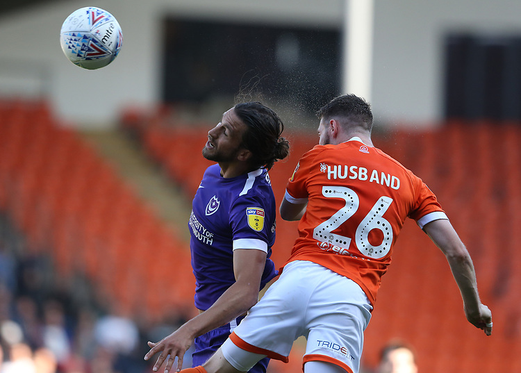Blackpool's James Husband battles with Portsmouth's Christian Burgess<br /> <br /> Photographer Stephen White/CameraSport<br /> <br /> The EFL Sky Bet League One - Blackpool v Portsmouth - Saturday 31st August 2019 - Bloomfield Road - Blackpool<br /> <br /> World Copyright © 2019 CameraSport. All rights reserved. 43 Linden Ave. Countesthorpe. Leicester. England. LE8 5PG - Tel: +44 (0) 116 277 4147 - admin@camerasport.com - www.camerasport.com