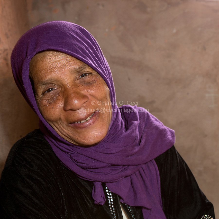 Morocco.  Amazigh Berber Woman in her Home, Ait Benhaddou Ksar, a World Heritage Site.