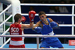 Glasgow 2014 Commonwealth Games<br /> Men's Fly (52kg) preliminary bout. <br /> Welsh boxer Andrew Selby (Blue) in action against Scotland's Reece McFadden (Red)<br /> 25.07.14<br /> ©Steve Pope-SPORTINGWALES