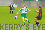 Killarney Celtic's Jeniffer Murphy gets away from Tralee Dynamos Annie Walsh at Cahermoneen, Tralee on Sunday.