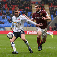 Bolton Wanderers' Josh Vela holds off the challenge from Northampton Town's Jak McCourt<br /> <br /> Photographer Alex Dodd/CameraSport<br /> <br /> The EFL Sky Bet League One - Bolton Wanderers v Northampton Town - Saturday 18th March 2017 - Macron Stadium - Bolton<br /> <br /> World Copyright &copy; 2017 CameraSport. All rights reserved. 43 Linden Ave. Countesthorpe. Leicester. England. LE8 5PG - Tel: +44 (0) 116 277 4147 - admin@camerasport.com - www.camerasport.com