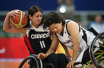 Sabrina Pettinicchi (11) of Montreal gets crashed into by Kimi Taneda of Japan in women's wheelchair basketball action at the Paralympic Games in Beijing,Tuesday, Sept., 9, 2008.    Photo by Mike Ridewood/CPC