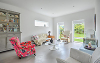 BNPS.co.uk (01202 558833)<br /> Pic: Mullucks/BNPS<br /> <br /> Lounge after.<br /> <br /> A retired couple dubbed 'the accidental upsizers' have put their luxury home on the market for a whopping £750,000.<br /> <br /> Jean and Desmond Lawton bought a suburban bungalow three years ago as they looked to downsize from a large property.<br /> <br /> But they soon decided that they didn't like the dated decour of the humble home and transformed it beyond recognition.<br /> <br /> They knocked down every internal retaining wall bar one to create an open-plan space and built a single-storey extension to the rear.