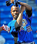 28 February 2011: New York Mets utilityman Willie Harris smiles with his former teammates prior to a Spring Training game against the Washington Nationals at Digital Domain Park in Port St. Lucie, Florida. The Nationals defeated the Mets 9-3 in Grapefruit League action. Mandatory Credit: Ed Wolfstein Photo