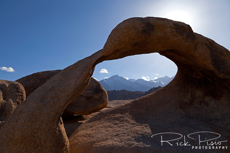 "Mobius Arch, in California's Alabama Hills State Recreation Area forms a portal to view  Mount Whitney. Since the 1920's film makers have been using the Alabama Hills as a backdrop for their movies. In the early days of motion pictures films such as ""Gunga Din"", ""How the West Was Won"", and ""Yellow Sky"" were filmed at a site within the recreation area known as ""Movie Flats. More recently movies such as ""Tremors"", ""Star Trek Generations,"" ""Gladiator"", ""Iron Man"", and ""Django Unchained"" were shot in the Alabama Hills."