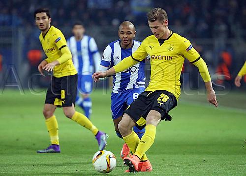 18.02.2016. Dortmund, Germany.  UEFA Europa League match at the Signal Iduna Park. Borussia Dortmund versus FC Porto. Nuri Sahin (Borussia Dortmund), Yacine Brahimi (FC Porto), Lukasz Piszczek (Borussia Dortmund)