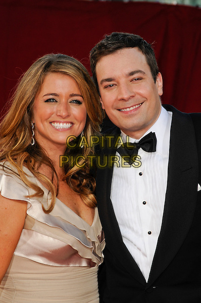 NANCY JUVONEN & JIMMY FALLON.Arrivals at the 61st Primetime Emmy Awards held at Te Nokia Theater in Los Angeles, California, USA. .September 20st, 2009 .emmys half length white silver silk satin dress black tuxedo married husband wife.CAP/ROT.©Lee Roth/Capital Pictures