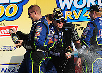 Sept. 28, 2008; Kansas City, KS, USA; Nascar Sprint Cup Series driver Jimmie Johnson (center) celebrates after winning the Camping World RV 400 at Kansas Speedway. Mandatory Credit: Mark J. Rebilas-