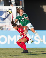 Bradenton, FL - Sunday, June 12, 2018: Makenna Morris, Aylin Avilez during a U-17 Women's Championship Finals match between USA and Mexico at IMG Academy.  USA defeated Mexico 3-2 to win the championship.