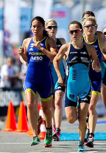 16 SEP 2012 - NICE, FRA - Andrea Hewitt (left) of Poisy Triathlon and, Ainhoa Murua (right) of TCG 79 Parthenay run shoulder to shoulder as they lead the front pack during the final round of the French Grand Prix triathlon series held during the Triathlon de Nice Côte d'Azur .(PHOTO (C) 2012 NIGEL FARROW)