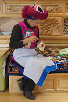 Diqing Tibetan Autonomous Prefecture, Yunnan Province, China - A Tibetan woman makes traditional handicrafts at home, August 2018.