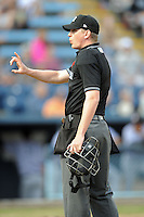 Home plate umpire Ryan Wills during a game between the Kannapolis Intimidators and the Asheville Tourists at McCormick Field on May 9, 2013 in Asheville, North Carolina. The Intimidators won the game 13-12. (Tony Farlow/Four Seam Images).