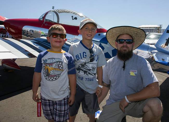 Five-year-old Henrey, seven-year-old Oliver and Paul Adanson during the National Championship Air Races in  Reno, Nevada on Saturday, Sept. 14, 2019.