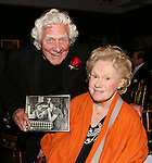 Joe Sirola, holding up a photograph of himself with Tammy Grimes,  at the '12th Annual Love N' Courage' celebrating David Amram and Tammy Grimes at The Players Club on March 2,, 2015 in New York City.