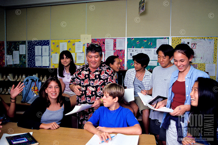 Punahou educator Joe Tsujimoto teaching a group of children