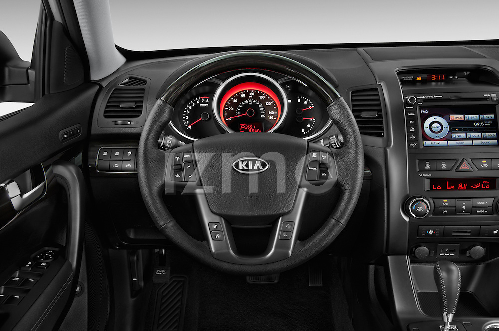 Steering wheel view of a 2013 KIA Sorento SX