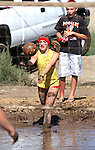 Photo by Cathleen Allison.Players compete in the MudFest 2010 mud volleyball tournament in Gardnerville, Nevada on Aug. 7, 2010. The event is the annual fundraiser for the Douglas High School volleyball program. The Electric Chickens won the 2010 title.