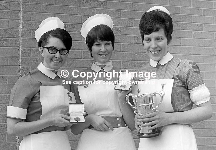 Prizewinning nurses at prizegiving at Musgrave Park Hospital, Belfast, N Ireland - from left - Maureen Dodd, Mary Monaghan and Rosemary Scott, all from Belfast. February 1970. 197002230064a<br /> <br /> Copyright Image from Victor Patterson, 54 Dorchester Park, Belfast, UK, BT9 6RJ<br /> <br /> Tel: +44 28 9066 1296<br /> Mob: +44 7802 353836<br /> Voicemail +44 20 8816 7153<br /> Email: victorpatterson@me.com<br /> Email: victorpatterson@gmail.com<br /> <br /> IMPORTANT: My Terms and Conditions of Business are at www.victorpatterson.com