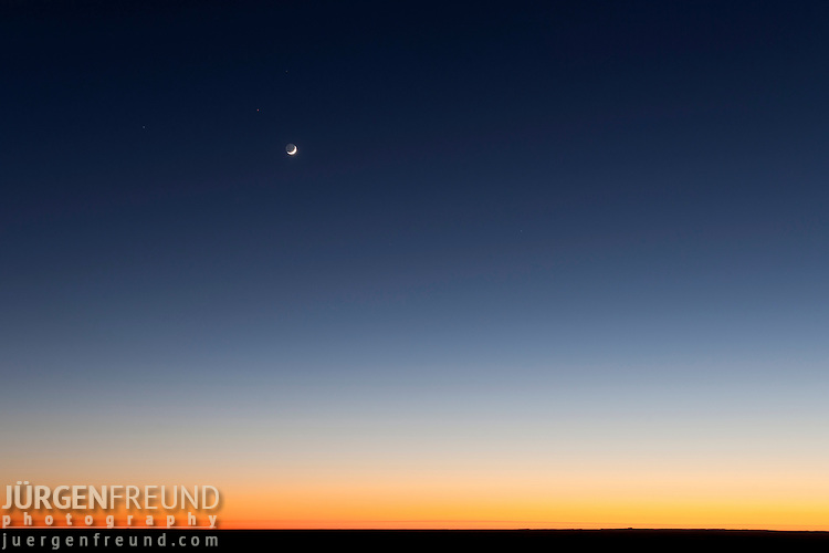 The flat Australian outback right after sunset with the sun's afterglow.