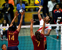 BOGOTÁ-COLOMBIA, 09-01-2020: Aleoscar Blanco y Ahizar Zuñiga de Venezuela, intenta un bloqueo al ataque de balón a Angela Leyva de Perú, durante partido entre Perú y Venezuela, en el Preolímpico Suramericano de Voleibol, clasificatorio a los Juegos Olímpicos Tokio 2020, jugado en el Coliseo del Salitre en la ciudad de Bogotá del 7 al 9 de enero de 2020. / Aleoscar Blanco and Ahizar Zuñiga from Venezuela, tries to block the attack the ball to Angela Leyva from Peru, during a match between Perú and Venezuela in the South American Volleyball Pre-Olympic Championship, qualifier for the Tokyo 2020 Olympic Games, played in the Colosseum El Salitre in Bogota city, from January 7 to 9, 2020. Photo: VizzorImage / Luis Ramírez / Staff.