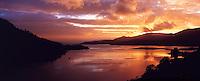 © David Paterson.Sunset on Loch Duich, with Eilan Donan Castle, west Invernesshire, Scottish Highlands...Keywords: sunset, sundown, evening, dusk, loch, sea-loch, fjord, calm, peaceful, tranquil, quiet, fire, Duich, Eilan, Donan, Inverness, Scotland, Highlands