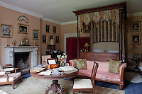 The Colonel's Room is furnished with an imposing four-poster bed and is decorated with illustrations and family ephemera