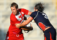 PICTURE BY VAUGHN RIDLEY/SWPIX.COM...Rugby League - International Friendly - England Knights v France - Leigh Sports Village, Leigh, England - 15/10/11…England's Joe Westerman is tackled by France's Jean-Philippe Baile.