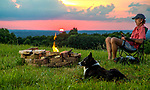 Mark Wallheiser and Dixie enjoy the sunset atop Mac's Hill in Shelbyville, Tennessee.