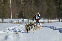 Marvin Kokrine, day three of the oldest continuously run sled dog race in the world, the 2003 Open North American Sled dog championships, Fairbanks, Alaska. The annual race consists of three daily races, the combined fastest time wins.