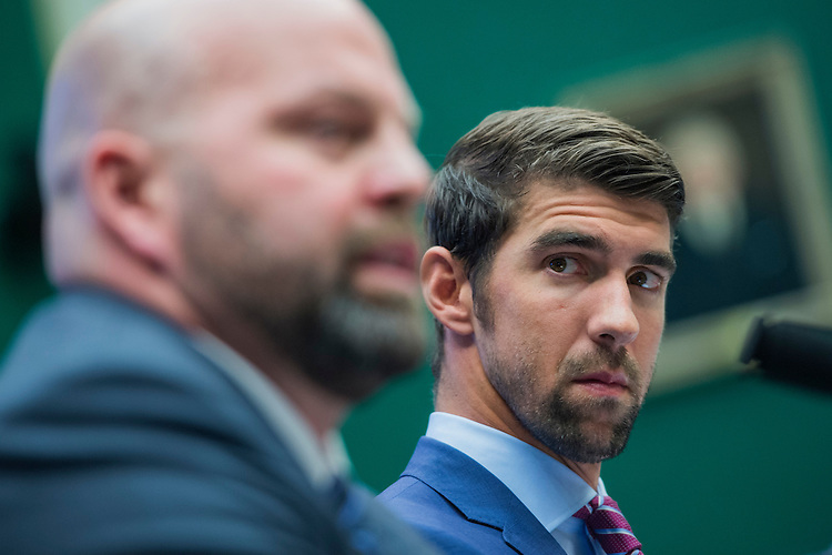 UNITED STATES - FEBRUARY 28: Olympic gold medalists Adam Nelson, left, and Michael Phelps, appear before a House Energy and Commerce Subcommittee on Oversight and Investigations hearing in Rayburn Building on ways to strengthen the international anti-doping system, February 28, 2017. Phelps is a swimmer and Nelson a shot putter. (Photo By Tom Williams/CQ Roll Call)