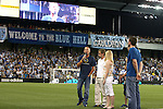 09 June 2011: Lance Armstrong (with microphone) talks to the crowd before the game. Sporting Kansas City played the Chicago Fire to a 0-0 tie in the inaugural game at LIVESTRONG Sporting Park in Kansas City, Kansas in a 2011 regular season Major League Soccer game.