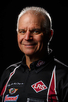 Feb 10, 2016; Pomona, CA, USA; NHRA funny car driver Tim Wilkerson poses for a portrait during media day at Auto Club Raceway at Pomona. Mandatory Credit: Mark J. Rebilas-USA TODAY Sports