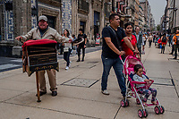 Moises Sanchez<br /> Organilleros, organ players in Centro Historico  on August 24, 2016 in Mexico City, Mexico. <br /> Photo Daniel Berehulak for The New York Times