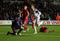 Pictured: Michu of Swansea (3rd L) celebrating his equaliser, making the score 2-2. Monday 16 September 2013<br />