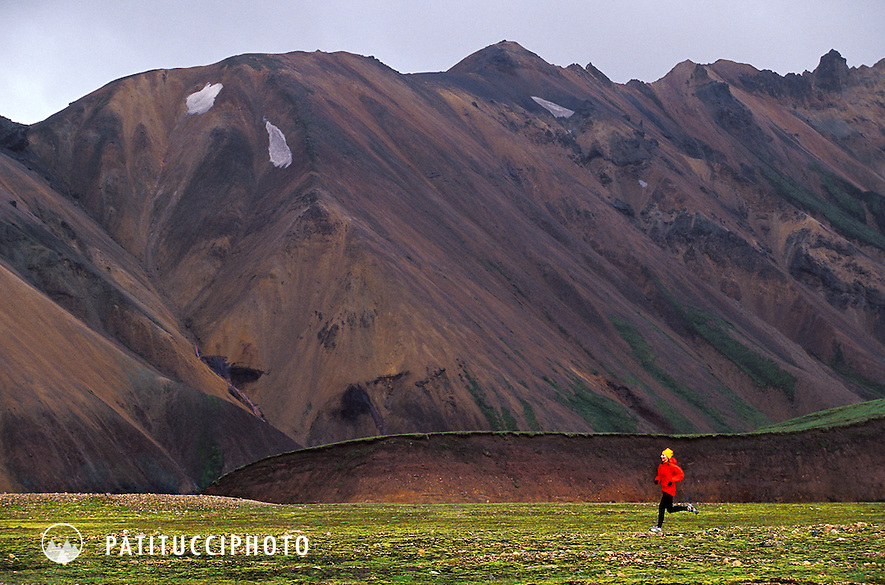 Trail runner in the dramatic landscape of the Landmannalaugar area of central Iceland.