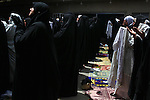 Women pray at the headquarters of Moqtada al-Sadr in Sadr City, Baghdad, Iraq, Friday, May 28, 2010. Women are not required to attend Friday prayers if they have small children to take care of.
