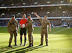 The Royal Marines with the matchball and the referee