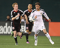 Dax McCarty (10) of D.C. United goes for a loose ball with David Beckham (23)  of the Los Angeles Galaxy during an MLS match at RFK Stadium, on April 9 2011, in Washington D.C.The game ended in a 1-1 tie.