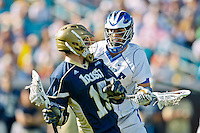 February 20, 2011:  Notre Dame attack Ryan Foley (15) is blocked by Duke midfielder Jake Tripucka (7) during Lacrosse action between the Duke Blue Devils and Notre Dame Fighting Irish during the Moe's Southwest SunShine Classic played at EverBank Field in Jacksonville, Florida. Notre Dame defeated Duke 12-7.