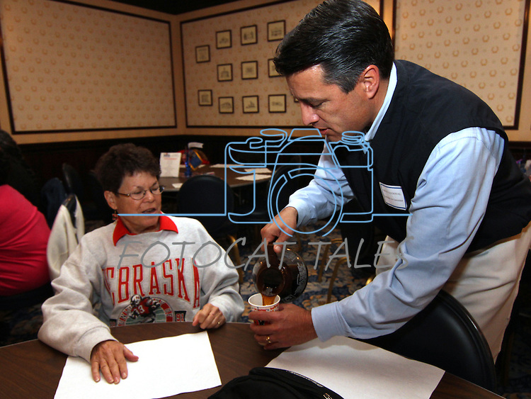 Gubernatorial candidate Brian Sandoval serves coffee to Jane Richards during the annual Carson City Republican Women's Nevada Day Pancake Breakfast at the Governor's Mansion on Saturday morning, Oct. 30, 2010, in Carson City, Nev. .Photo by Cathleen Allison