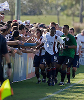 USA's Charles Renken (10), Carlos Martinez (11), Earl Edwards (1) celebrate their first goal with the fans. 2007 Nike Friendlies, which are taking place from Dec. 6-9 at IMG Academies in Bradenton, Fla.