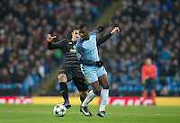Kelechi Iheanacho of Manchester City turns Erik Sviatchenko of Celtic during the UEFA Champions League GROUP match between Manchester City and Celtic at the Etihad Stadium, Manchester, England on 6 December 2016. Photo by Andy Rowland.
