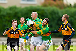 Cathal Conor Patrick Curtin Moyvane In action against Dylan Hartnett and Alan Crean in the County Football League at Conolly Park Tralee on Sunday.